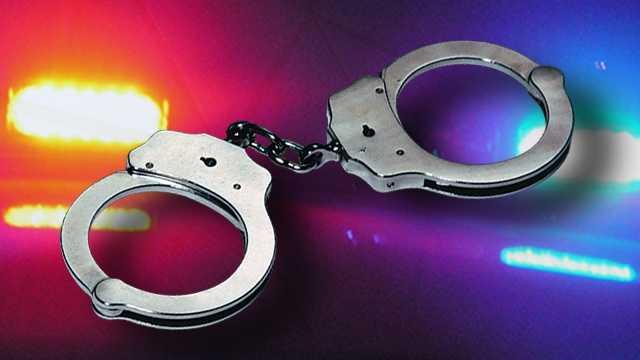 34653134-arrest-handcuffs-police-lights-widescreen.jpg