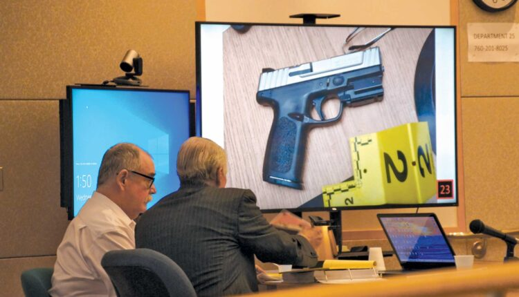 Andrew-Williams-with-his-attorney-and-evidence-photo-of-the-gun-displayed-during-trial-CREDIT-Eva-Knott.jpg