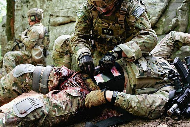 Special-Operations-Combat-Medic-applying-tourniquet-on-wounded-warrior.jpg